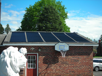 Solar Pool Heating Collectors mounted on a garage roof, Schenectady, NY, Schenectady County