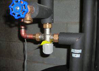 A necessary component of all Solar Thermal Systems, the Mixing Valve, protects building occupants from excessive water temperatures, Verbank, Dutchess County, NY