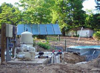 Six 4'x10' Solar Hot Water Collectors, ground-mounted, being constructed while new pool is installed, Central Valley, Orange County, NY