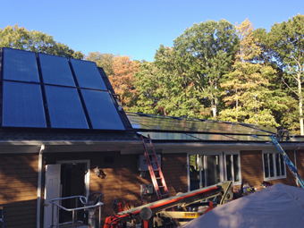 Two 6-Collector Solar Thermal Systems upper roof and forground of lower roof heat the pool and domestic hot water Port Jefferson NY Suffolk County