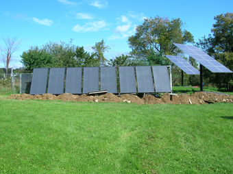 Eight SunEarth Solar Thermal Collectors heat three 120 gallon tanks, providing domestic hot water and assisting Radiant Heating System, Westerlo, Greene County, NY